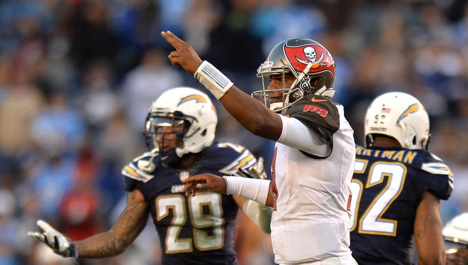 Tampa Bay Buccaneers quarterback Jameis Winston and San Diego Chargers cornerback Craig Mager (29) react during a game earlier this season.