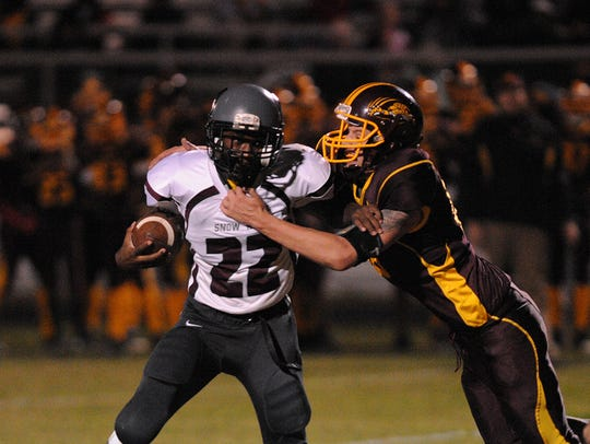 Snow Hill Quarterback Ameer Fisher scrambles to get