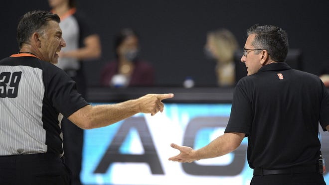 Connecticut Sun coach Curt Miller, right, argues a call with official Mike Price during the first half against the Chicago Sky, Tuesday, Sept. 15, 2020, in Bradenton, Fla. The Sun won 94-81.