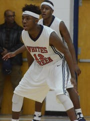 Whites Creek's Isaiah Bowers (12) scored a game-high 30 points in Tuesday's District 10-AA win over Stratford.