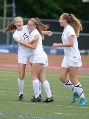 Avery Fenchel celebrates her first goal of the game with Laine Fenchel and Julia Stadtherr (right.)