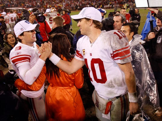 Jan 22, 2012; San Francisco, CA, USA; New York Giants quarterback Eli Manning (10) shakes hands with kicker Lawrence Tynes (9) after the 2011 NFC championship game against the San Francisco 49ers at Candlestick Park.  Mandatory Credit: Chris Faytok/THE STAR-LEDGER via USA TODAY Sports