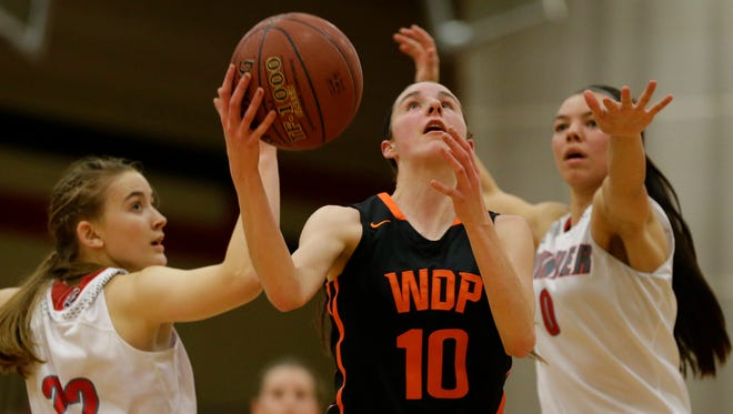 West De Pere's Brehna Evans (10) drives to the basket past Seymour's McKendra Heinke (22) and Hailey Oskey (0). West De Pere was one of three local teams to receive a top seed in the WIAA girls basketball playoffs.