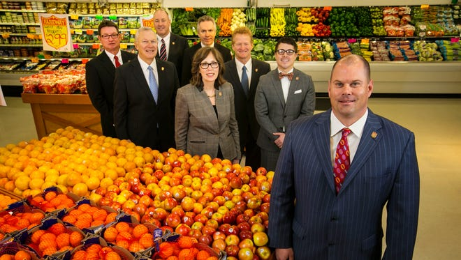 Fareway CEO Reynolds Cramer, right, is shown with the grocery chain's management team at the Boone store. From left are Patrick Hagan Sr., vice president/finance; Fred Greiner, president; Mike Mazour Sr., vice president/human resources; Craig Shepley, in back, chief financial officer; Roxanne Kanne-Roush, vice president/training and development; Scott Beckwith, chief administrative officer; and Garrett Piklapp, secretary/general counsel.