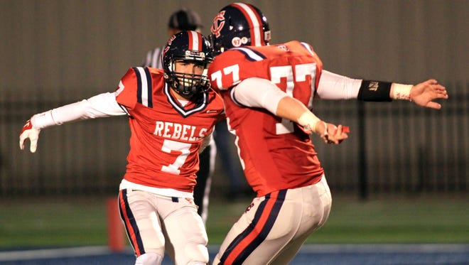 Teurlings Catholic's Nathan Arceneaux (7) and Greg Grappe (77) celebrate Arceneaux's touchdown against  Northside in a high school football game Friday, November 7, 2014, at TCHS in Lafayette, La.