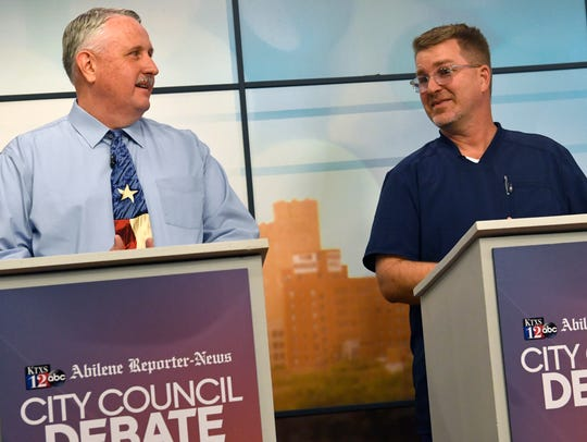 Shane Price (left) and Clinton Embry answer a question asking them to say something nice about their opponent during Wednesday's City Council debate. The debate was held at KTXS-TV studios in partnership with the Abilene Reporter-News.