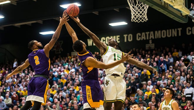 UVM's #15 Ra Kpedi snags the rebound over Albany during their game in Burlington, Vt., on Wednesday night, Jan. 24, 2018. UVM won, 61-50.