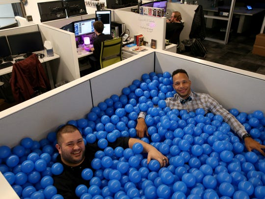 """Joe Hutt and Elvis Montero in the """"ball pit"""" at Datto"""