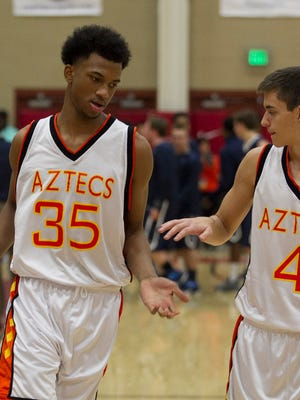 Corona del Sol's Marvin Bagley III (left) high-fives teammate Jeffrey McCain (4) before the Hoophall West basketball showcase at Chaparral High in Scottsdale on Jan. 3, 2015.