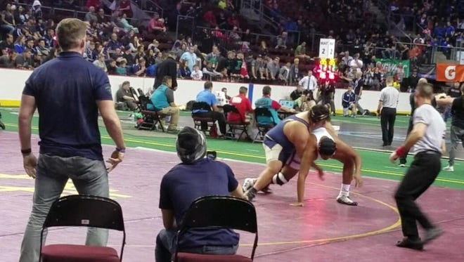 Ruidoso High School's Mikey Marin wrestles for the heavyweight state title Feb. 18 in a double overtime match.