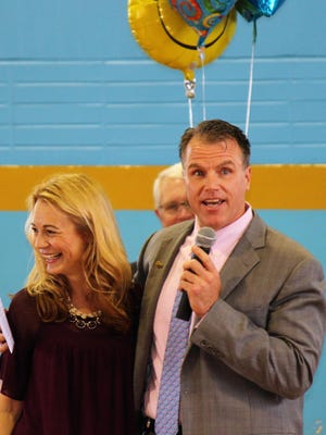 Jennifer Nauman, 2016 Distinguished Principal of the Year for Delaware, receives a hug from Cape Henlopen Superintendent Robert S. Fulton.