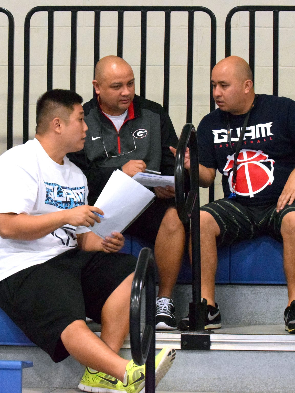 Coaches Jimmie Yi (left) Sid Guzman (center) and Eddie