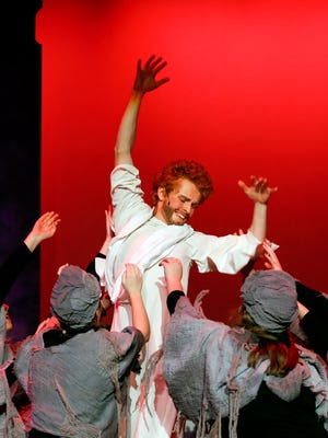 """Lepers reach out to touch Jesus, played by Joseph Collum, in Sacred Heart Academy's production of """"Jesus Christ Superstar,"""" which has three performances left this weekend."""