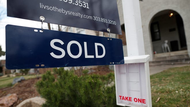 In this Wednesday, March 28, 2018, photograph, a sold sign is shown outside a single-family home on the market in Denver. On Wednesday, June 20, the National Association of Realtors reports on sales of existing homes in May.
