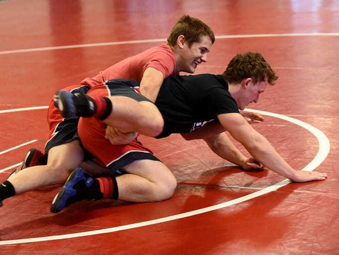 Licking Valley's Addison Fogle spars with Austin Schotts