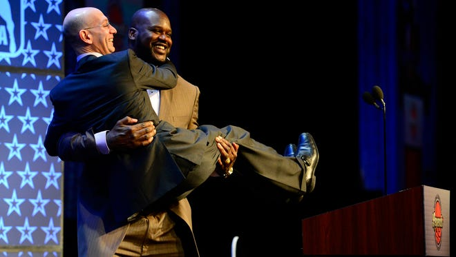 NBA legend Shaquille O'Neal picks up NBA commissioner Adam Silver as O'Neal is honored as the Legend of the Year during the 2014 NBA All-Star Game Legend Brunch.