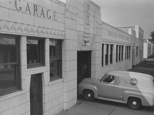 A Coca Cola delivery van enters the garage of the bottling