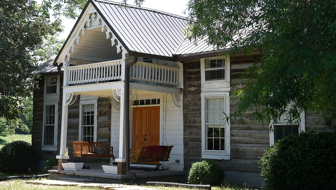 Brian and Sally Oxley now own the log home and the acreage that make up the old Johnny Cash farm in Bon Aqua, Tenn.