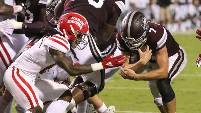 After falling to quarterback Nick Fitzgerald (7) and Mississippi State last Saturday, UL safety Corey Turner (6) and the Ragin' Cajuns face Kilton Anderson and Coastal Carolina's spread-option offense this Saturday.