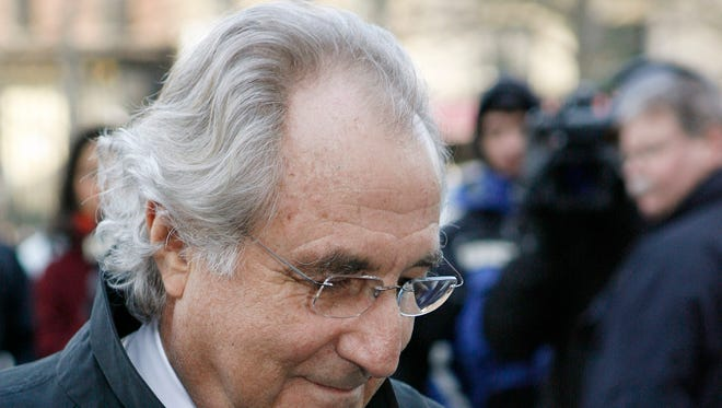 FILE - In this Jan. 14, 2009 file photo, Bernard Madoff arrives at Federal Court in New York. The longtime secretary of the imprisoned financier and four other back-office subordinates of the Ponzi king go to trial Tuesday, Oct. 8, 2013, as the government for the first time shows a jury what it has collected in its five-year probe of one of history's biggest frauds. (AP Photo/Stuart Ramson, File) ORG XMIT: NY107
