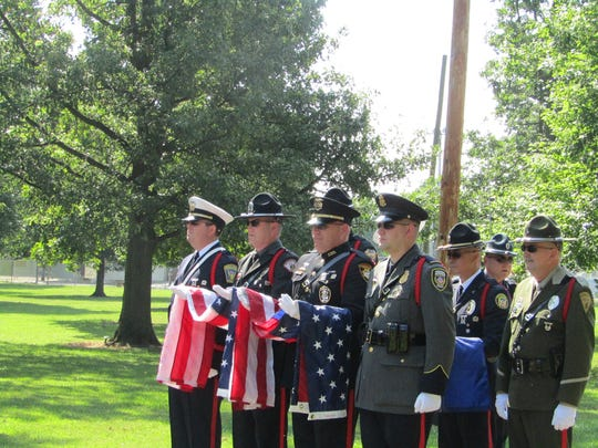 Officers honor FBI Special Agent Nelson Klein, who died in a 1935 shootout in West College Corner, Ind. A historical marker commemorating the shootout was dedicated on Aug. 16, 2017.