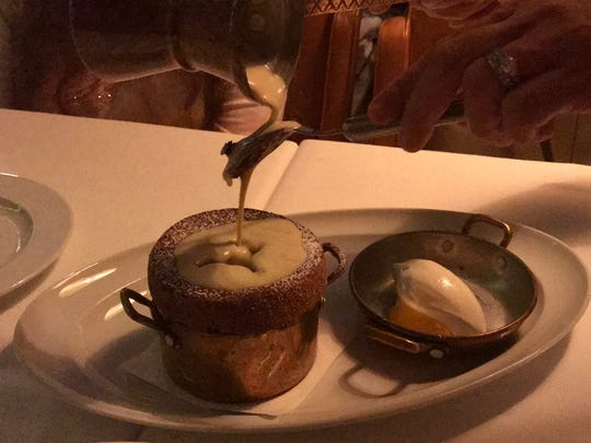 The chocolate souffle with Grand Marnier creme anglaise spreads like a virus at Sails. When one goes by, three more are ordered.