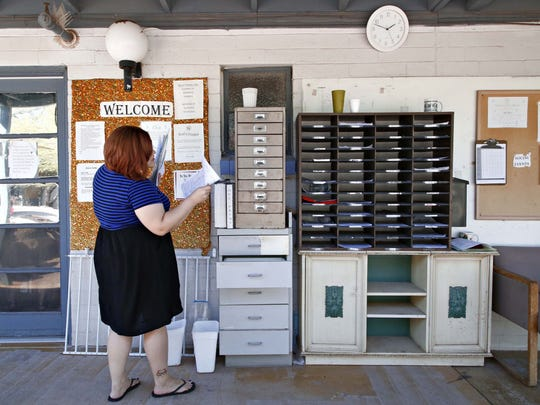 Heather McNeeley checks on paperwork filled out by