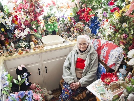 From 2015: With ice still melting on the streets outside, Myrtle Cason sits for a portrait inside her kitchen where artificial flowers give off a sense of spring's approach.