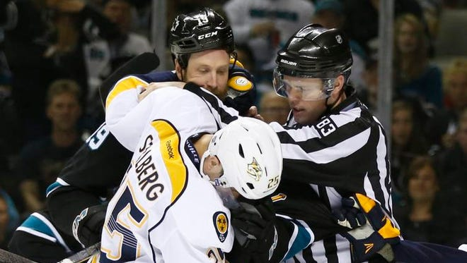 Sharks center Joe Thornton and Predators left wing Viktor Stalberg mix it up during the second period.