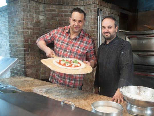 Brothers Vincenzo (left) and Giovanni Barone in Giovanni's Collingswood restaurant, Villa Barone.