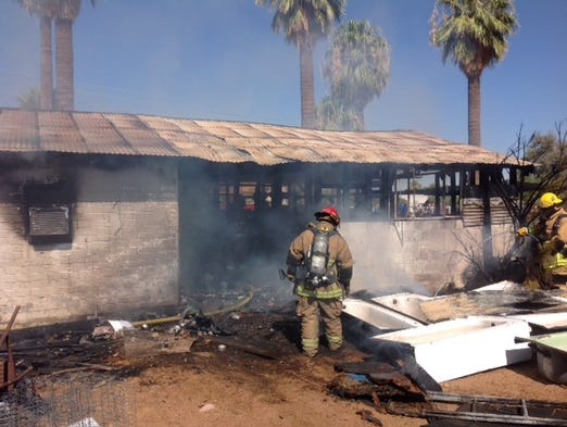A house fire in Phoenix on Aug. 7, 2014. Three dogs died in the fire.