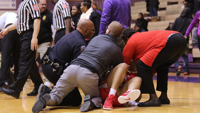 A player on the court was helped after a brawl was broken up between Pike and Ben Davis high school girls basketball teams.