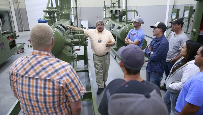 Ken Johnson, the School of Energy interim dean, teaches a class on April 12, at San Juan College. The school is set to graduate six students in the coming months.