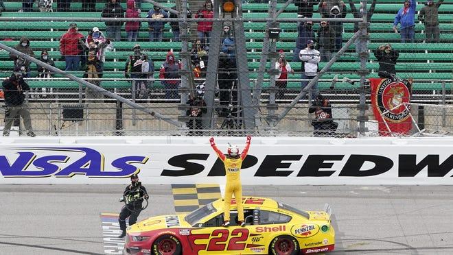 Joey Logano celebrates after winning the Hollywood Casino 400 NASCAR Cup Series race Sunday at Kansas Speedway.