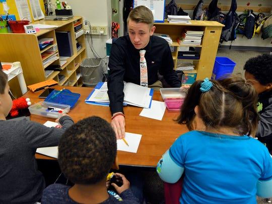 Student teacher Brian Baker works with children in