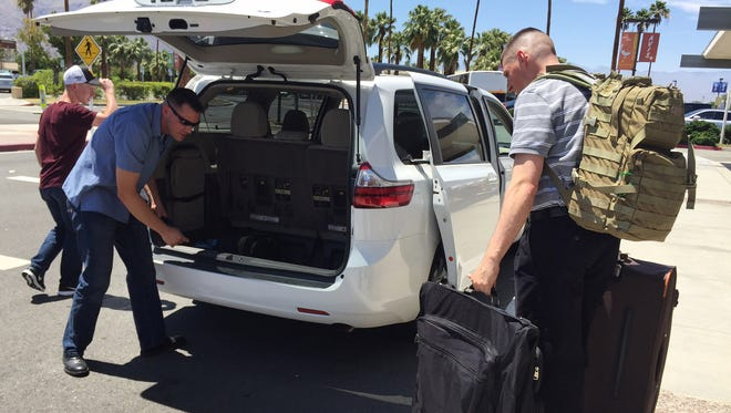From right, Marine Corps Warrant Officer David Sheer, 31,Master Sgt. Matthew Wolnik, 40 and Lance Corp. Eric Jaap, 19 (in cap) load their gear into a Soldiers Organized Services (S.O.S.) van at Palm Springs International Airport on Sunday, June 5, 2016. SOS transported the Marines to Marine Corps Air Ground Combat Center, Twentynine Palms.