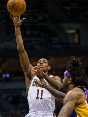 Milwaukee Bucks guard Brandon Knight (11) shoots the ball over Los Angeles Lakers forward Jordan Hill (27) during the fourth quarter at BMO Harris Bradley Center March 27. The Bucks won 108-105.