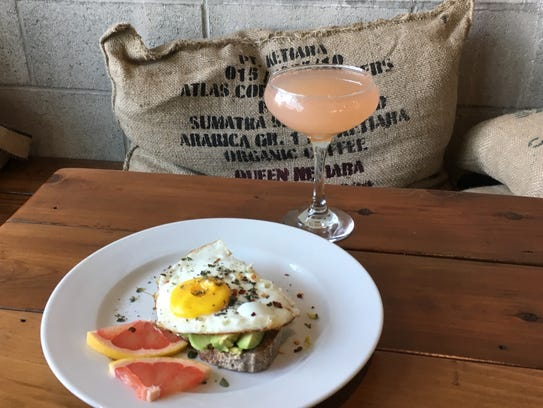 Brunch items at Harvest Cafe in downtown Ventura have included grapefruit mimosas and avocado smorgas topped with an egg.