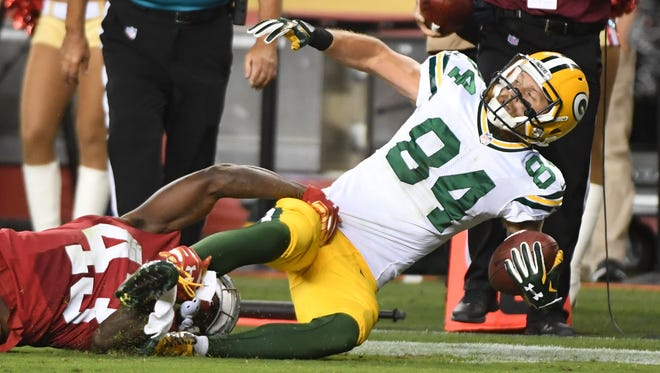 Green Bay Packers wide receiver Jared Abbrederis (84) is tackled by San Francisco 49ers cornerback Chris Davis (43) during the second quarter at Levi's Stadium.