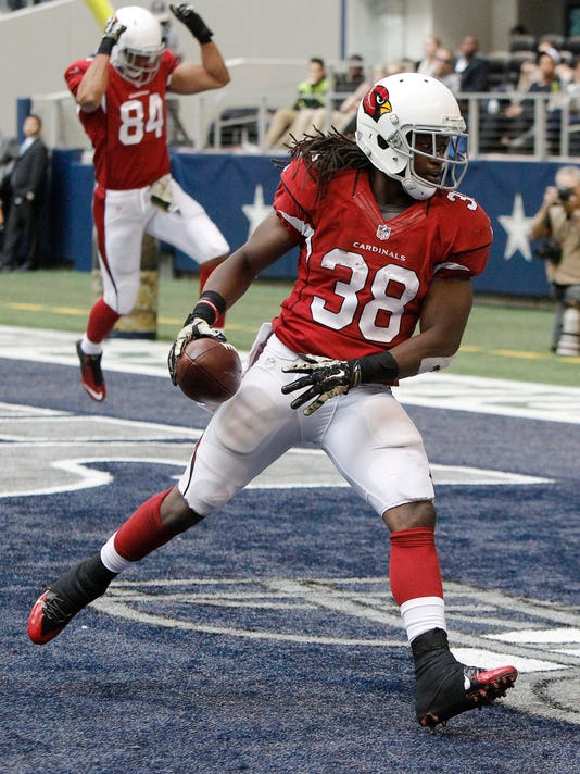 Arizona Cardinals running back Andre Ellington (38) makes a touchdown reception against the Dallas Cowboys during the second half of an NFL football game Sunday, Nov. 2, 2014, in Arlington, Texas. (AP Photo/Brandon Wade)