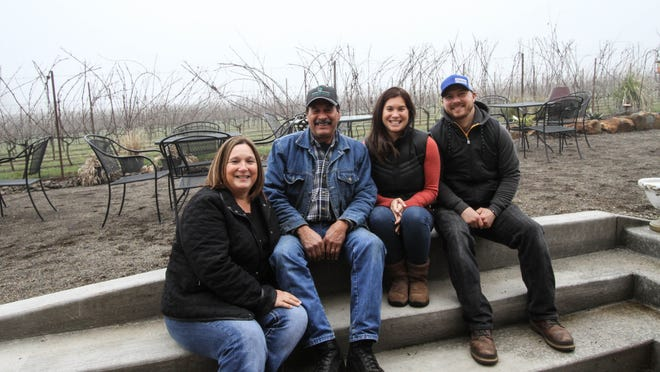 Janice and Luis Coria (from left) are co-owners of Coria Estates, Salem's newest winery. Their daughter Aurora Coria-Day is winemaker, and her husband, Brandon Day, is in charge of marketing and promotions.