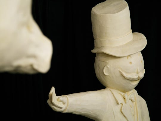 "The fifth butter sculptor for the Iowa State Fair, Sarah Pratt of West Des Moines, apprenticed with Norma ""Duffy"" Lyon for 15 years until she took over in 2006. This will be Pratt's 10th cow at the fair which is accompanied by pieces from the Monopoly board game which Pratt works on at the Fairgrounds on Tuesday, August 11, 2015."