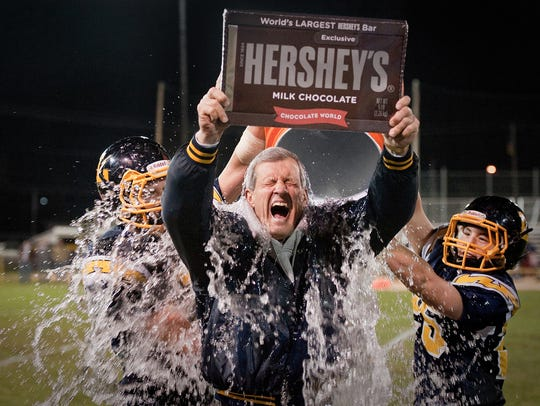 Littlestown head coach Mike Lippy is doused with ice