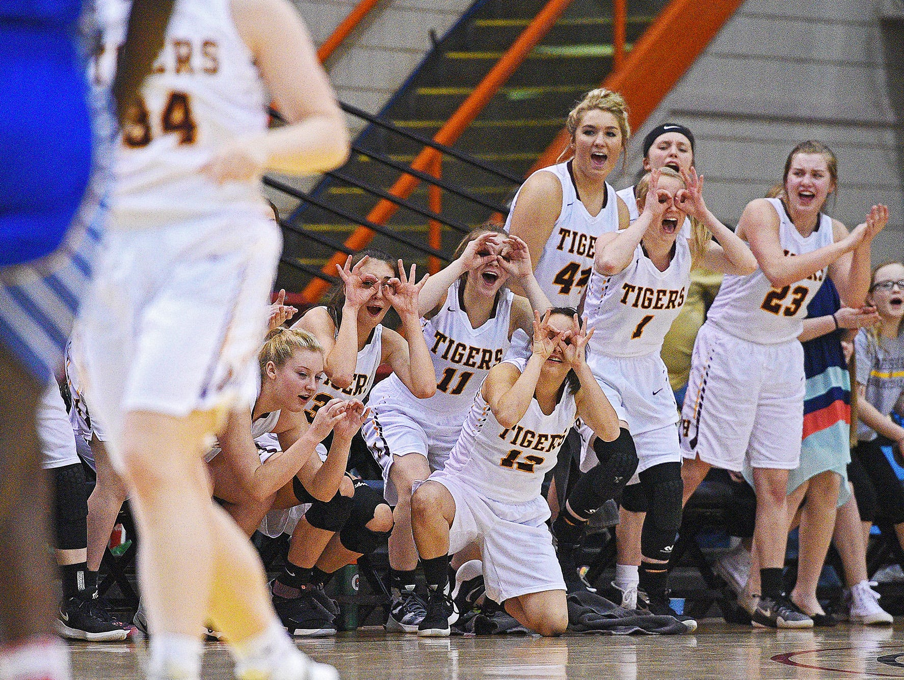 Harrisburg players react from the bench after a teammate scored during the 2017 SDHSAA Class AA State Girls Basketball championship game against O'Gorman Saturday, March 18, 2017, at Rushmore Plaza Civic Center in Rapid City.