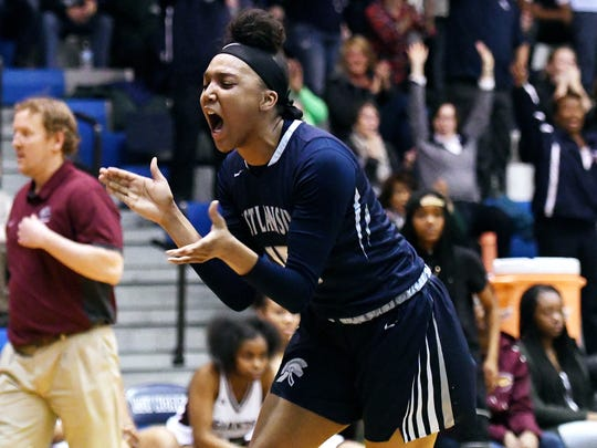 East Lansing's Jaida Hampton celebrates after an assist to teammate Amelia McNutt to finish the second quarter on Tuesday, March 6, 2018, at Loy Norrix High School in Kalamazoo.