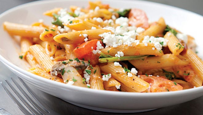 The Penne Rosa from Noodles & Company is pasta topped with mushrooms, tomato and spinach in a spicy tomato cream sauce.