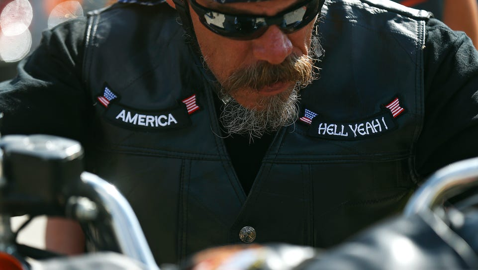 A motorcycle rider gets ready to participate in the