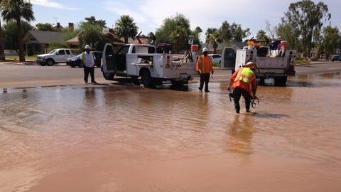 A water-main break flooded Seventh Avenue in downtown Phoenix on July 8, 2014.