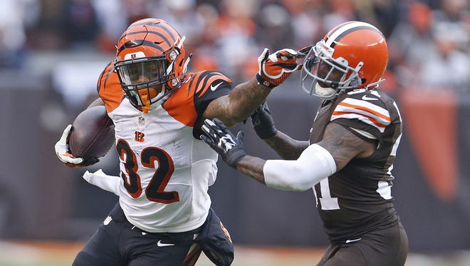 Bengals running back Jeremy Hill stiff-arms Browns strong safety Donte Whitner during the second quarter.