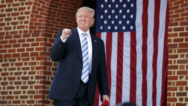Republican presidential candidate Donald Trump arrives to speak at a campaign rally at Regent University, Saturday, Oct. 22, 2016, in Virginia Beach,